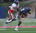 Ole Miss' Derrick Herman (26) catches a pass as Wesley Pendleton (6) defends during a team scrimmage at Vaught-Hemingway Stadium in Oxford, Miss. on Saturday, August 20, 2011.
