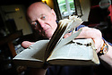Philip Douetil, Surrey, with the First World War Bible of Arthur Ingham whose life was saved when a piece of shrapnel became embedded in it.  Arthur was best friends with Philip's grandfather, John Moody.Photo by Clare Kendall.