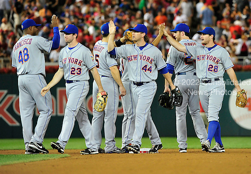 New York Mets celebrate their 2 - 0 victory over the Washington Nationals at Nationals Park in Washington, D.C. on Saturday, August 18, 2012. .Credit: Ron Sachs / CNP.(RESTRICTION: NO New York or New Jersey Newspapers or newspapers within a 75 mile radius of New York City)
