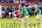 Dromids Criostóir Ó Fairrcheallaigh runs out of options as Skelligh Rangers Gerard O'Sullivan & Bernard Walsh close in.