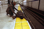Ethan Carlson, a teenage homeless runaway lays dangerouly close to BART tracks as his friend comes to his aid as a train approaches In San Francisco, California.