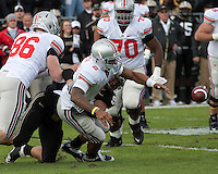Purdue defensive end Ryan Kerrigan (94) forces Ohio State quarterback Terrelle Pryor (2) to fumble the ball. The Purdue Boilermakers defeated the Ohio State Buckeyes 26-18 at Ross-Ade Stadium, West Lafayette, Indiana on October 17, 2009..
