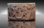 Picture of Neo-Hittite orthostat describing the legend of Gilgamesh from Karkamis,, Turkey. Ancora Archaeological Museum. Mythological scene. The 2 figures in the center are flanked by lion headed men who have one fist outstretched and are known as Ugallu. The 2 figures in the middle holding spears are men with bodies of bulls known as Kusarikku. 1