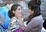 Zoya Hameed (right), a physician from the United Kingdom, comforts Hanin, a frightened Syrian refugee girl, on a beach near Molyvos, on the Greek island of Lesbos, on October 30, 2015. The girl was on a boat full of refugees that traveled to Lesbos from Turkey. The boat was provided by Turkish traffickers to whom the refugees paid huge sums to arrive in Greece. Hameed is one of hundreds of volunteers on the island who receive the refugees and provide them with warm clothing and medical care before they continue their journey toward western Europe.