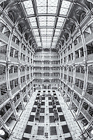 The beautiful interior of the George Peabody Library, a part of Johns Hopkins University, in Baltimore, Maryland.  The building was opened to the public in 1878.