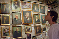 Gallery employee arranges paintings and sculptures made in the style of socialist realism depicting Soviet leader Vladimir Ilyich Lenin. Large number of artifacts from Hungary's socialist past found in the basements of different ministries after a change in political power. These communist pictures and sculptures are now being prepared for a charity auction to support those affected by the recent red sludge catastrophe in Hungary. The auction drawing great attention from around the world is to be held on December 6th in Budapest, Hungary. Photos taken during preparations for the auction on November 25, 2010. ATTILA VOLGYI