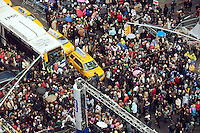 "Thousands upon thousands of revelers pack Times Square on Saturday, December 31, 2011, claiming their spots for the midnight ball drop. Mild weather predicted for New Year's Eve is expected to bring well over a million people to pack the ""Crossroads of the World"" celebrating the incoming 2012. (© Richard B. Levine)"