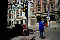 Toronto (ON) CANADA, April 19, 2007<br /> <br /> A pedestrian wait outside a Starbuck coffe shop, to cross  King Street East