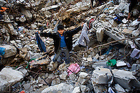 Gaza city, Jan 25 2009.Children searching the rubble of the Al Daia family home..23 people, mostly women and children were killed instantly when the Israeli air force dropped 2 bombs on the Al Daia family home in the southern part of Gaza city at 5:45AM. There was no fighting in the area at the time.