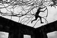 Jose Rodriguez, a freerunner from Plus Parkour team, jumps on the top of ruined walls of an abandonned school in the outskirts of Bogotá, Colombia, 22 February 2016. Parkour, originally developed in France during the late 1980s from military training, is a physical activity, focused on the art of movement and overcoming obstacles in a strictly urban environment. Practitioners of parkour employ running, climbing, jumping, rolling and other movements to pass through any urban area the most efficient way possible.