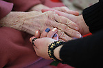 A Palestinian nurse provides treatment for an elderly Palestinian woman at El Wafa elderly nursing home, in Gaza city on Feb. 12, 2017. El Wafa elderly nursing home was established in 1980 as one of programs of Al-Wafa charity association. El-Wafa hospital was destroy during the 50-day war between Israel and Hamas militants in the summer of 2014 by Israeli forces. Photo by Sana'a Al-Ajez
