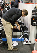 Mike Higgins takes care of Derek Army's (PC - 19) skates. - The Boston University Terriers defeated the visiting Providence College Friars 4-2 (EN) on Saturday, December 13, 2012, at Agganis Arena in Boston, Massachusetts.