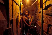Poor family lives in an abandoned school in a Rio de Janeiro shantytown, Brazil.