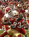 Kansas City Chiefs linebacker Marvcus Patton (53) tackles San Francisco 49ers wide receiver J.J. Stokes (83)  around the neck on Sunday, November 10, 2002, in San Francisco, California. The 49ers defeated the Chiefs 17-13.