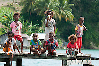 Raja Ampat Archipelago, West Papua, Indonesia, December 2010. The arrival of western toursits in kayaks stirrs up the villagers of Wawiay, children en grown ups alike are coming out to welcome us and to do a testride with our kayaks. Thousands of small islands fringed by coral reefs and blue water mangroves litter the Raja Ampat archipelago. The turquoise and blue waters are teeming with marine life that forms the livelihood for the local Papuan population. The Raja Ampat Research & Conservation Centre (RARCC) supports the locals to develop a community based, sustainable tourism project, inviting visitors to explore their islands by sea kayak and experience the culture by staying amongst the local people in traditional style homestays. Photo by Frits Meyst/Adventure4ever.com