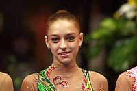 Evgenia Kanaeva of Russia smiles during event final awards at 2006 Portimao World Cup of Rhythmic Gymnastics on September 10, 2006 at Portimao, Portugal.  (Photo by Tom Theobald)
