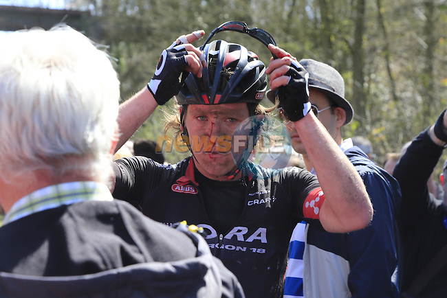 Shane Archbold (NZL) Bora-Argon 18 takes a heavy fall on Sector 18 la Trouee de Arenberg during the 113th edition of the Paris-Roubaix 2015 cycle race held over the cobbled roads of Northern France. 12th April 2015.<br /> Photo: Eoin Clarke www.newsfile.ie