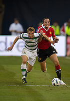 16 July 2010 Manchester United John O'Shea No.22 and Celtic FC James Forest No. 49 in action during an international friendly  between Manchester United and Celtic FC at the Rogers Centre in Toronto..Manchester United won 3-1.