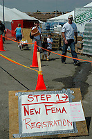 The K-Mart parking lot in Waveland Ms., has become a shoppng mecca for displaced people after Hurricane Katrina and a place to register with FEMA and the SBA.