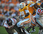 Tennessee tailback Tauren Poole (28) is tackled by Ole Miss defensive tackle Jerrell Powe (57) in a college football game at Neyland Stadium in Knoxville, Tenn. on Saturday, November 13, 2010. Tennessee won 52-14.