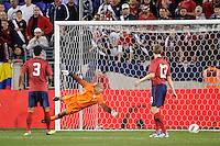 United States goalkeeper Tim Howard (1) dives for a shot that went wide. The men's national team of the United States (USA) was defeated by Ecuador (ECU) 1-0 during an international friendly at Red Bull Arena in Harrison, NJ, on October 11, 2011.