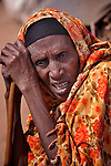 Fatima Hassan Mohammed, an 80-year old Somali woman who fled drought and war in her country, rests outside her makeshift hut in the Dadaab refugee camp in northeastern Kanya. She arrived five months ago, and some other family members who arrived in the last week helped her make her hut, an improved model over what she had before. Tens of thousands of newly arrived Somalis have swelled the population of what was already the world's largest refugee camp.