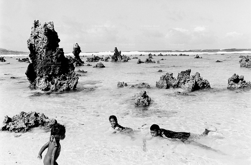 Republic of Nauru. Central Pacific. Nauru is a tiny island (21 square-km). Coral pinnacles in the pacific ocean. Children swim and play in the salted sea water.  © 1999 Didier Ruef
