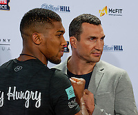 GERMANY: Anthony Joshua and Wladimir Klitschko pose during the press conference to Anthony Joshua vs. Wladimir Klitschko at RTL media group mall on February 16, 2017 in Cologne, Germany.<br />