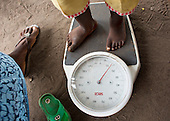 Patient being weighed in MSF mobile clinic in Central African Republic
