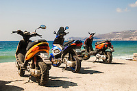 colorful mopeds parked at the sea in Greece