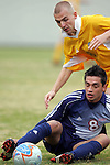 27 November 2005: SMU's Bruno Guarda (below) plays by the seat of his pants as UNC-G's Jokull Elisabetarson (above) tries to steal the ball. Southern Methodist University defeated the University of North Carolina at Greensboro 3-1 at UNC-G Soccer Stadium in Greensboro, North Carolina in a 2005 NCAA Men's Soccer Tournament game.