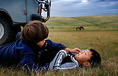 Autistic child Rowan, 5, communicates with six-year-old Bodibilguunson. He is the son of Mongolia guide. .Rowan is riding a horse in Mongolia, accompanied by his parents Rupert and Kristin..Rowan's parents believe horses and shamans can unlock their sonís autistic mind. This is their journey of discovery across Mongolia on horseback. .The story is published by the Sunday Times and accompany text by Tim Rayment.