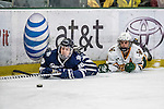 10 February 2017: University of New Hampshire Wildcat Forward TylerKelleher, a Senior from Longmeadow, MA, works for puck control over University of Vermont Catamount Forward Travis Blanleil, a Junior from Kelowna, British Columbia, in the first period at Gutterson Fieldhouse in Burlington, Vermont. The Wildcats came from behind to defeat the Catamounts 4-2 in the first game of their 2-game Hockey East Series. Mandatory Credit: Ed Wolfstein Photo *** RAW (NEF) Image File Available ***
