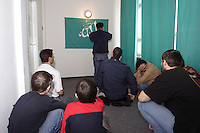 Chechen men and children listening to the subsidiary Imam while the midday Ramadan pray in the arranged Mosque in the URiC Radom refugee Centre. .-For security reason, the face of the adult asylum seeker have been evicted of the photography..-For security reason, the names of the adult asylum seeker have been change. .-Article 9 of the Act of 13 June 2003 on grating protection on the Polish territory (Journal of Laws, No 128, it. 1176) personal data of refugees are an object of particular protection..-Cases where publication of a picture or name of asylum seeker had dramatic consequences for this persons and is family back in Chechnya. .Please have safety of those people in mind. Thank you.