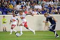 Juan Agudelo (17) of the New York Red Bulls is chased by Jordan Harvey (26) of the Vancouver Whitecaps. The New York Red Bulls and the Vancouver Whitecaps played to a 1-1 tie during a Major League Soccer (MLS) match at Red Bull Arena in Harrison, NJ, on September 10, 2011.