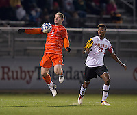 Austin Savage (5) of Clemson takes control of the ball in front of London Woodberry (22) of Maryland during the game at the Maryland SoccerPlex in Germantown, MD. Maryland defeated Clemson, 1-0, in overtime.  With the win the Terrapins advanced to the finals of the ACC men's soccer tournament.