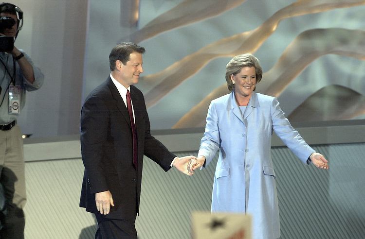 DNCconvention30(DG)081700-- Al Gore and his wife Tipper on stage during the democratic national convention in California.