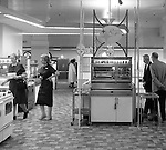 Pittsburgh PA: View of Christmas in store display at Horne's department store in downtown Pittsburgh. Customers shopping for a new steel kitchen appliances surrounded by a steel display during the Rhapsody of Steel campaign.  US Steel launched an awareness campaign of all the current uses of steel in everyday products.  During this time, ALCOA Aluminum Company of America also headquartered in Pittsburgh, was aggressively competing to enter markets where US  steel companies traditional dominated market share. Examples included beer and food Cans, appliances, automobile parts, children toys / bicycles, and more.
