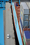 "Dock workers at the APM Terminal at the Port of Rotterdam, load containers onto the ""Elly Maersk"" one of eight PS-class container ships in the Maersk Line fleet, on Tuesday Oct. 27, 2009, in Rotterdam, the Netherlands. The ""Elly Maersk"" is one of the largest container vessels in the world, with an overall length of 397 meters and a width of 56 meters, it is capable of carrying 11,000 TEU (Twenty foot Equivalent Unit - a 20 foot long container). (Photo © Jock Fistick)"