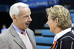 14 November 2014: UNC men's head coach Roy Williams (left) meets with women's head coach Sylvia Hatchell (right) before the game, which was Sylvia's first on the sideline in over a year after sitting out the previous season while being treated for leukemia. The University of North Carolina Tar Heels hosted the Howard University Bison at Carmichael Arena in Chapel Hill, North Carolina in a 2014-15 NCAA Division I Women's Basketball game. UNC won the game 83-49.
