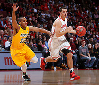 Ohio State Buckeyes guard Aaron Craft (4) is guarded by North Dakota State Bison guard Lawrence Alexander (12) during the first half of Saturday's NCAA Division I basketball game at Value City Arena in Columbus on December 14, 2013.(Barbara J. Perenic/The Columbus Dispatch)