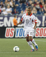 D.C. United defender Ethan White (15) looks to pass. In a Major League Soccer (MLS) match, the New England Revolution (blue) tied D.C. United (white), 0-0, at Gillette Stadium on June 8, 2013.