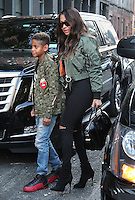 NEW YORK, NY - OCTOBER 4: La La Anthony and son Kiyan arrive at Kim Kardashian's apartment following Kim Kardashian's kidnapping and robbery in Paris in New York, New York on October 4, 2016. Photo Credit: Rainmaker Photo / MediaPunch