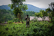 A villager from Mabauram village is seen patrolling and keeping a vigil while other villagers go and collect vegetables and other personal items from their burnt village. Ethnic clashes are regularly taking place between Zeme Nagas and the Dimasa tribe in North Cachar Hills. Suspected Dimasa group killed 2 youths (aged 16 and 14) and burnt 21 houses out of 25 in village Mabauram in the outskirts of Haflong, Assam, India.