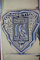 Competitor Trophy HALEIWA, HI Dec. 1, 2005 The opening ceremony of the Quiksilver in Memory of Eddie Aikau was held today at Waimea Bay. This year's event  will be held on one day , between December 1, 2005 and February 28, 2006, when the waves eceed the  20 foot  minimum threshold and the 28 invitees will compete for the $98.000 prize purse...The northern hemisphere winter months on the North Shore signal a concentration of surfing activity with some of the best surfers in the world taking advantage of swells originating in the stormy Northern Pacific. Notable North Shore spots include Waimea Bay, Off The Wall, Backdoor, Log Cabins, Rockpiles and Sunset Beach... Ehukai Beach is more  commonly known as Pipeline and is the most notable surfing spot on the North Shore. It is considered a prime spot for competitions due to its close proximity to the beach, giving spectators, judges, and photographers a great view...The North Shore is considered to be one the surfing world's must see locations and every December hosts three competitions, which make up the Triple Crown of Surfing. The three men's competitions are the Reef Hawaiian Pro at Haleiwa, the O'Neill World Cup of Surfing at Sunset Beach, and the Billabong Pipeline Masters. The three women's competitions are the Reef Hawaiian Pro at Haleiwa, the Gidget Pro at Sunset Beach, and the Billabong Pro on the neighboring island of Maui...Photo: Joliphotos.com