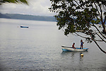 Central America, Latin America, Costa Rica. Two girls in their boat on the Golfo Dulce.