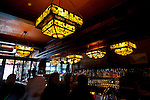 The antique bar with Tiffany glass style light fixtures at McMenamin's Olympic Club Pub in Centralia, Washington State.
