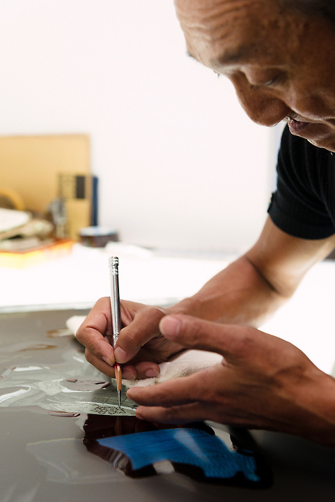 Retouching a film negative. Benrido collotype atelier, Kyoto, Japan, October 9, 2015. The Benrido collotype atelier in Kyoto was founded in 1887 and is the only full-scale commercial collotype atelier in the world. Collotype is a historic photographic printing process that makes use of plates coated in gelatine. It produces prints of unrivalled quality.