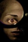 Feman looking through magnifying glass