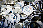 The American Federation of Teachers hand out buttons for a protest at the Wisconsin State Capitol over a bill that threatens to strip collective bargaining rights in Madison, Wisconsin, February 26, 2011. Crowds swelled Saturday as protests enter their 12th day.